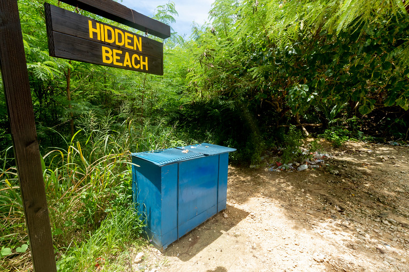 HIDDEN BEACH SIGN, PARKING-AREA DUMPSTER, AND GARBAGE