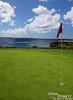 Blue ocean, green green, and red flag.  Tinian in the background.
