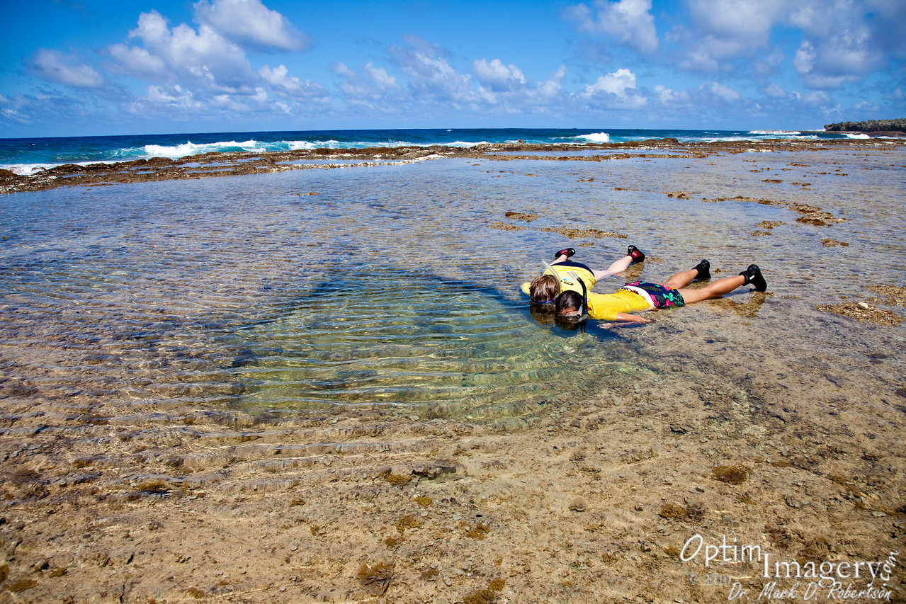 So THAT'S how you snorkel!  Lie down on the ground and peer in.  Definitely works for this small hole.