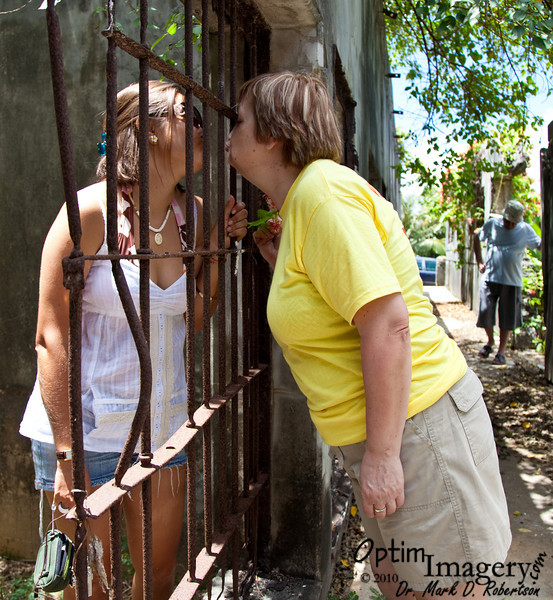 Well, at least she gets a kiss through the bars from her Mom!