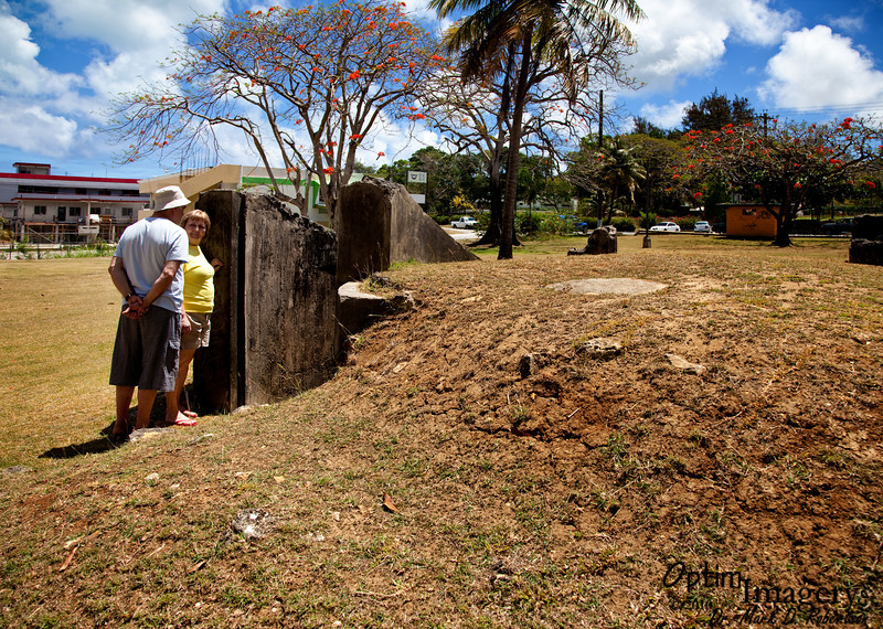 Boris and Udmila look at a bomb shelter on the grounds of the museum.
