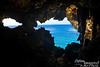 Here is the view out the cave.  One of my favorite views on island.<br /> <br /> You can see Tinian on the horizon.