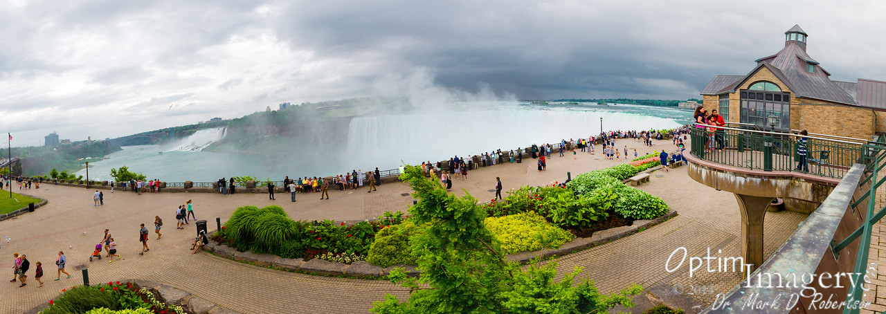 7-photo panorama.  The Canadian (Table Rock) visitor center (where the previously-photographed restaurant is located) to your right, then (from right to left), Horseshoe Falls, Goat Island, Bridal Veil Falls (looks quite small in this photo, but you'll see lots of water gushing over it in the next album), and American Falls.