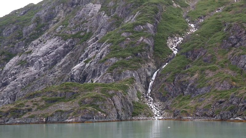 WATERFALL AND LAMPLUGH GLACIER WITH KAYAKERS