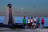 This group of joggers was enjoying the moon rise and asked for a group shot.  The moon was just right for the photo at this time.