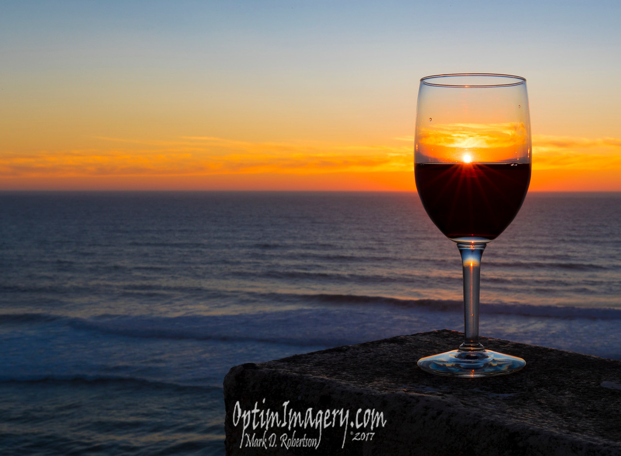 Not a Tequila Sunrise, but a Pinot Noir Sunset. The idea of the photo through the wine glass was all Bev's (I copied -- but I think she got a better shot). I do like the apparent candle in the handle.