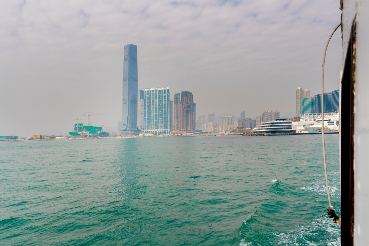 LOOKING BACK AT KOWLOON FROM THE HONG KONG FERRY