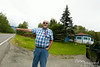 Dennis used to live in Sutton, AK.  He drove us out to his old homestead.  The house he lived in is gone, but the house behind him, he says, looked pretty much the same when he lived there as it does now.  Here, he is telling us what was to his left.