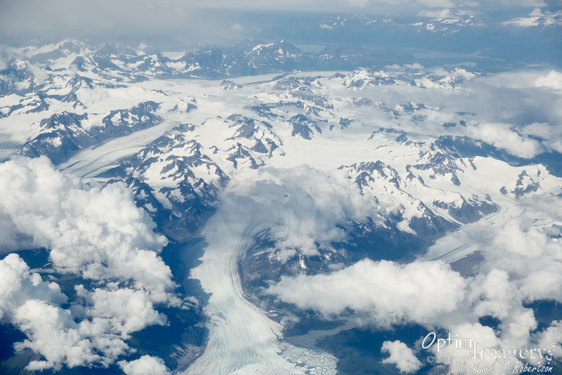 For about the first 30 minutes or so of our flight, we were above unbroken clouds, so could not see anything beneath them.  Then, the clouds slowly broke up to reveal spectacular glaciers and ice fields.