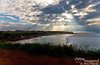 From Hookipa Lookout.  Watching surfers as the sun approaches the western horizon.
