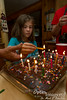 Destiny lights the candles for Grandma's birthday cake.