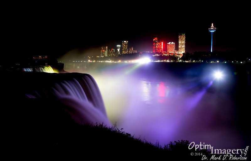 Night time looking toward Ontario, Canada over American Falls.  The lighting changes constantly until midnight.  10-second exposure.