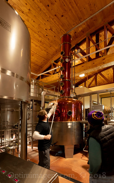 Tom watches as Brad......does whatever the master distiller does with that contraption.