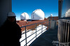 """On the catwalk surrounding the Subaru housing.  You see the twin Keck observatories.  The smaller dome to the right is the Canada-France-Hawaii Telescope Facility.<br /> <br /> For more on the Subaru Telescope, click on the following:    <a href=""""http://www.naoj.org/Introduction/outline.html"""">http://www.naoj.org/Introduction/outline.html</a>"""