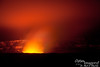 Night time view from Jaggar Museum.  The rim around Kilauea has a circumference of about 8 miles.  The  Halema`uma`u pit crater is about 2,500 feet by 2,900 feet, with a depth of about 300 feet down to the liquid lava pool (the molten lava producing the glow you see in the steam is about 300 feet below the surface at the  Halema`uma`u pit crater -- in other words, the glow you see in the lowest part of the steam is from lava 300 feet below!).