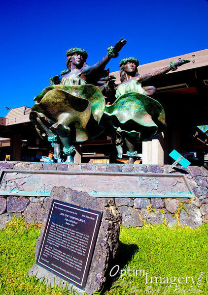 Bronze hula statue at Kona Airport, as I await boarding to come home.