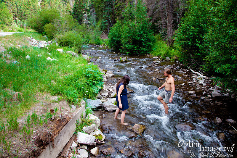 Zac and Stepha take a dip in the Red River as we walk to town for our yearly feast at the Sundance.
