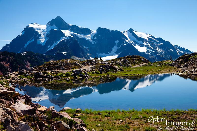 Mount Shuksan reflected in a little pool.