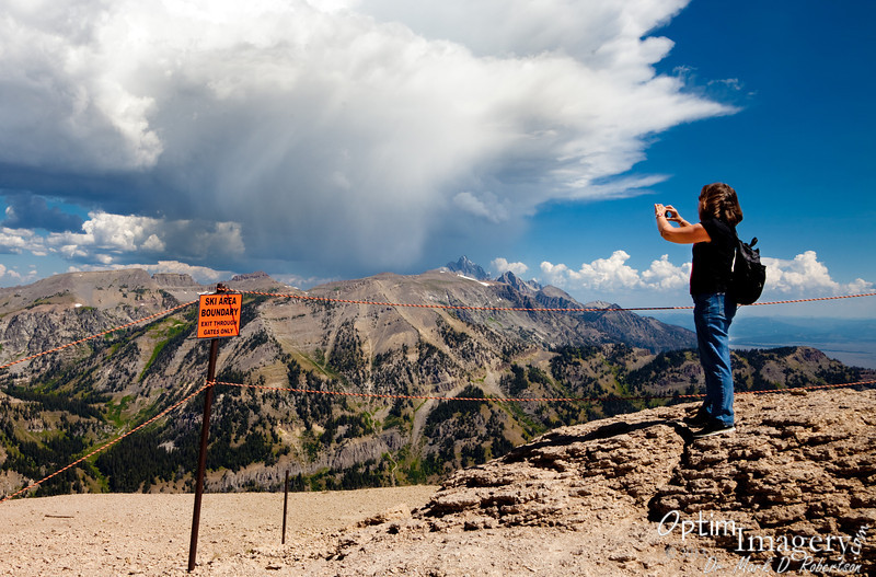 On top of Rendezvous Mountain, looking north, watching storms form over the Grand Teton.