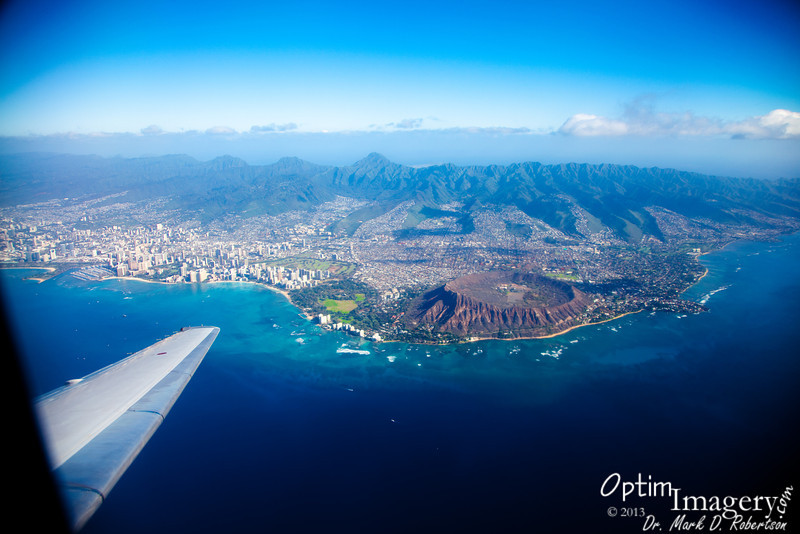 Flight from Honolulu to Maui.  Waikiki along the shore to left of center.  Diamond Head to right of center.