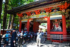 """Entrance to Toshogu.  <br /> <br /> When Ieyasu died, he asked to be enshrined in Nikko (he specifically requested that it be a SMALL shrine, and it is thought that he wanted something rather low key) because he believed that this would allow him to serve as a guardian from evil demons from the north, hopefully allowing him to ensure longevity of the Tokugawa regime.<br /> <br /> To build this """"small"""" shrine his grandson (Iemitsu) hired 4.5 million artisans, craftspeople and general workers, who labored for 1.5 years, using 2.4 million sheets of gold leaf (enough to cover about 6 acres).  Ancient Japanese cedar trees were planted over a 20-year period.  I can't find any figures as to how many were planted, but supposedly 13,000 of these trees (planted in the 1600's) are still standing (and alive)."""