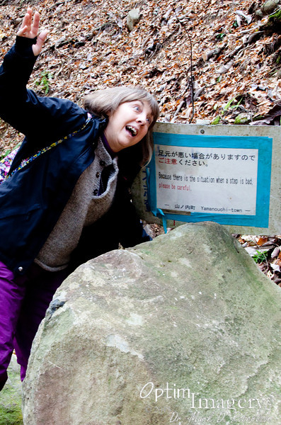 """In case you can't read the warning sign, it says """"Because there is the situation when a step is bad, please be careful.""""  Bev is demonstrating the """"situation."""""""