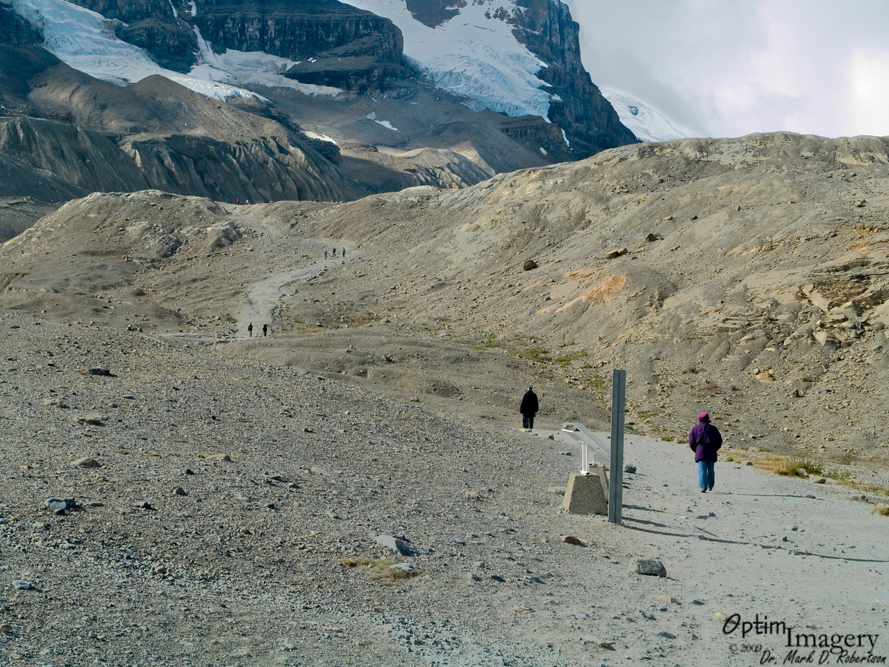 NOW we are at the mighty Athabasca Glacier.  Well, you won't see the glacier until we get to the top of this ridge, actually.  When Bev and I were there 30 years ago, the glacier was just to the bottom of the ridge you see here.