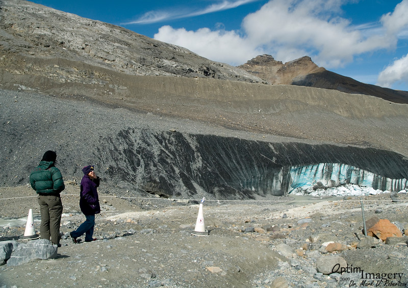 In some areas, the glacier gets covered by rock slides, etc.  This protects the glacier from melting, and allows those portions to remain in that area after the rest of the glacier has retreated.