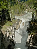 Here, just behind the fence, you can see Bri, Zac, and Bev.  On the other side of the fence (from them) is Sunwapta Falls.