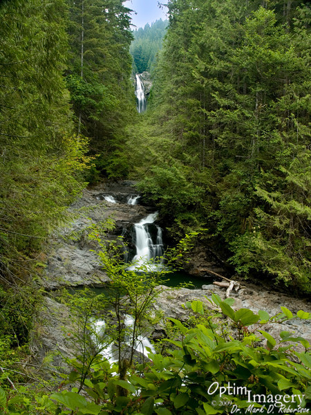 """Lower Wallace Falls.  The falls and park are actually named after Joe and Sarah Kwayaylsh, members of the Skykomish tribe who were the first to homestead in this area.  Apparently the english speakers who came later had difficulty pronouncing """"Kwayaylsh,"""" so they corrupted the name to """"Wallace.""""  Oh well:  Maybe better to have something named after you incorrectly than not named after you at all!"""