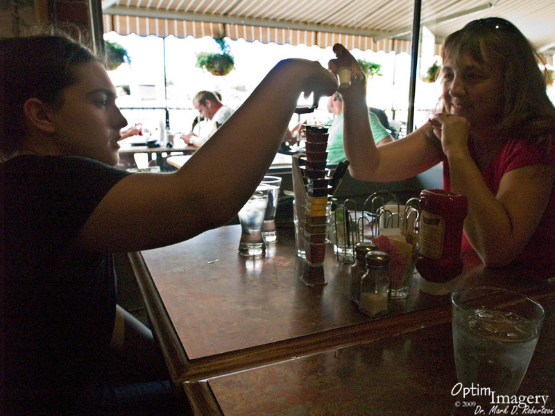 We ate at a rather odd local restaurant.  Here Bri and Bev stack the jellies.  Can they put any more on the stack?
