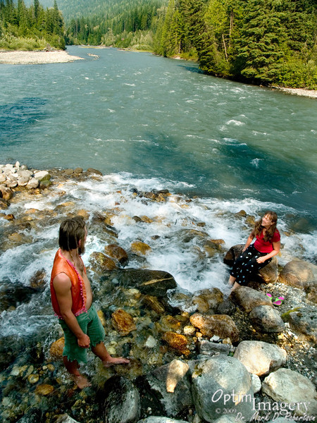 Bev and Zac soaking their feet in the Illecillewaet River.