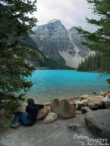 """Moraine Lake (and Lake Louise, and several other lakes of the high Canadian Rockies) receive melt water almost directly from glaciers.  The water is therefore carrying lots of finely-ground """"rock flower"""" from the action of the glacier.  This suspended rock flower results in a nearly mesmerizing and intense aqua glow to the water."""