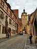 """Rothenburg ob der Tauber is one village along the Romantic Road. Here is an example of my odd internal mental musing:  What makes all this stuff """"romantic?""""  To some extent, it may be from the quaint appearance of shops and dwellings which have served citizens since 1170.  However, to a greater extent it is the watch towers, stately castles, and enclosing walls which give the character we see as """"romantic."""" In their day, all these things were built not for romantic effect, but for defense. I guess this should not be surprising:  Chivalry arose from warrior knights, right? Yet there seems to be something deeply interesting and fascinatingly disheartening in the thought that the necessity of great expenditure to protect one's village from Man's violent inhumanity and cruelty is necessary for our crafts (art, architecture, etc.) to develop into a strong embodiment of the romantic.<br /> <br /> Yin and Yang of ancient Europe?"""