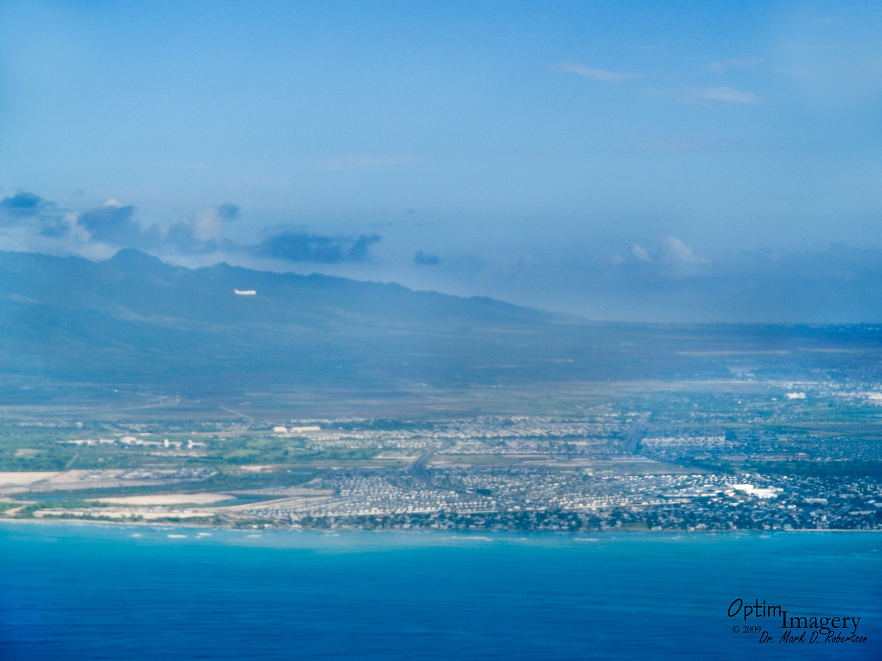 Sharing airspace with a NW flight on approach to Honolulu International Airport.
