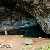 """....we came upon Waikanaloa Cave, for obvious reasons called """"Wet Cave.""""  Hawaiian legend says that Pele (goddess of volcanoes:  Much more about her coming in the Big Island albums {stay tuned!}) dug this as a home for her lover, but she then abandoned it when it filled with water.  I'm not sure what then came of her lover, although I do know that she had several, through the years.  Reportedly, SCUBA divers have found this place pretty sterile, not having any fish or other non-microscopic life."""