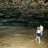 """Manini-holo Cave.  According to legend, this cave was dug by Manini-holo, chief fisherman of the Menehune (dwarfs, or little people) in search of the supernatural beast akua, who had been stealing their fish.  It was actually carved by wave action eons ago.  It is commonly called """"Dry Cave.""""  I wondered about this common name, until......"""