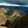 The white dot above the waterfall is a helicopter.  Notice the rainbow above and to your right from the falls.  Waimea Canyon is supposedly the largest canyon on any Pacific island, and is called The Grand Canyon of the Pacific.  It is more than a mile wide and 3,000 feet deep, although  I did not pace it off to check for sure.