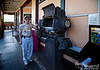 I can't remember the name of this restaurant, but it's south of Kailua-Kona, probably in or near the town of Captain Cook.  It's in a building which used to house a movie theater.  Here you see Dad telling how this old Peerless arc-projector worked.  Quite a piece of equipment, if you ask me.