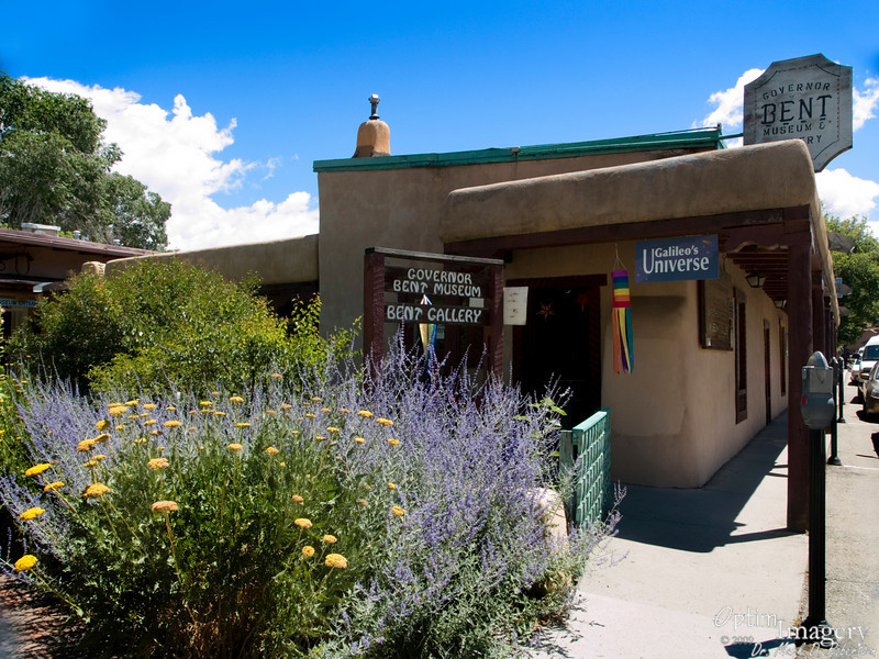 """Mom, Dad, Marsha, Steve, and I headed over to Taos, location of the home of the first governor of the territory of New Mexico after its incorporation into the United States.  Charles Bent was a highly successful fur trader and businessman in the early 1800's.  He made no secret of his disdain for the locals, stating that """"they have no opinion of their own, they are entirely governed by the powers that be, they are without exception the most servile people that can be imagined….. The Mexican character is made up of stupidity, obstinacy, ignorance, duplicity and vanity.""""  It's no wonder, then, that when he was named the territory's first American governor by the great White government back east., he was unpopular among many of the natives.  A group of Native Americans and Hispanics broke into this house January 19, 1847 and killed Charles Bent and several others who were visiting at the time.  (It wasn't entirely a personal thing:  The rebels believed that, once they had eliminated the American government from their lands, Mexico would come marching in to reclaim the territory).  Click """"Map This"""" above for location."""