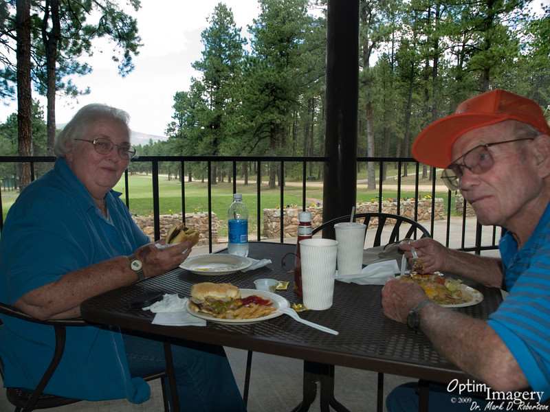 """Well, Scott, Glen, Stacey, Barret, Charley, Jim, Delores, Marsha, Steve, and Taz had all left.  Mom and Dad decided that they just as well take the lone remaining fellow (me) on a super trip to the south.  Here, we have a meal at Pendaries.  Set in a beautiful bowl-valley in the Sangre de Cristo mountains east and a little north of Santa Fe, this is basically a golf course and development area -- for people who REALLY like golf and the mountains.  They do make a mean burrito, and also good hamburger and fries.<br /> <br /> <br /> If you are curious about where these were taken, selected photos are mapped.  Have fun with the """"Map This"""" feature, accessible by clicking the little """"i"""" in the circle."""