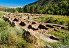 """So now we go from the old to the ancient.  Frijoles Canyon, in Bandelier National Monument.  <br /> <br /> Dad is standing in the center of the Tyuonyi Pueblo.  While there is evidence of people in this valley dating back more than 10,000 years, this village was built and inhabited in the 1300's and 1400's.  It was probably two stories high in places, with about 400 rooms, providing living and working space for about 100 people.<br /> <br /> Click the """"Map This"""" button above and you will have access to an amazing aerial view of these ruins (from the map page, click on photo #3 in the right-hand panel, and then zoom in by use of the top of the zoom arrow in the upper left -- If you have a large screen and get the message that detail does not exist in this area for that zoom level, just click the minus sign on the bottom of the zoom tool to 'unzoom' a bit.)."""