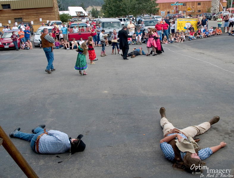 Three people shot and on the ground.  A rollicking good time.