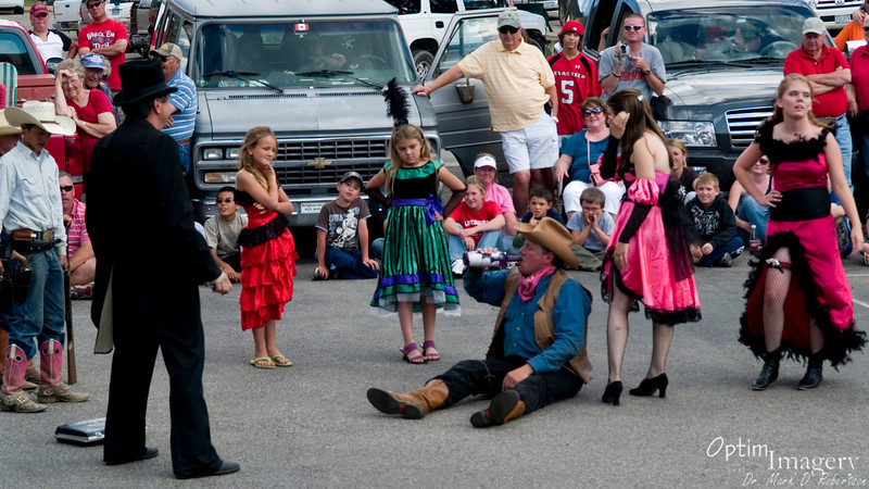 I'm not sure whether it's medicine or embalming fluid.....<br /> And yes, most of the actors were EXTREMELY young, as you can see from the cowboy to the left and the dance hall girls throughout the photo.
