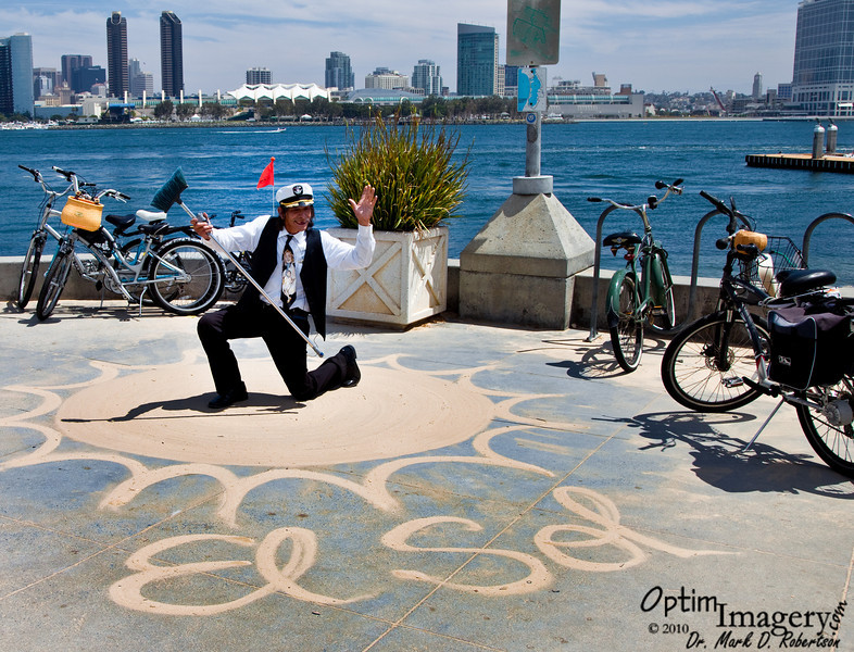 The San Diego Sandman rides his bike (his is the one furthest to your right) to places, spreads sand, and spreads it out with his broom to create temporary art.  You can hear his story in the next video.