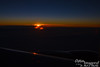 The first peak of a sunrise over the Pacific Ocean.  Probably somewhere near southern Alaska.