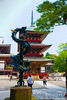 I believe that this dragon, about to devour the sword he climbs on, is brand new.  Ornate three-tiered pagoda in the background.
