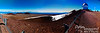 180 degree panorama looking nearly north (to your left), east (near the center of the photo), and south (to your right).  Notice all the small cinder cones.<br /> <br /> If you bring this one up to full size, you can see Hilo (near center) and the steam from Kilauea (just to your left from the little hill to the left of the Gemini Telescope.
