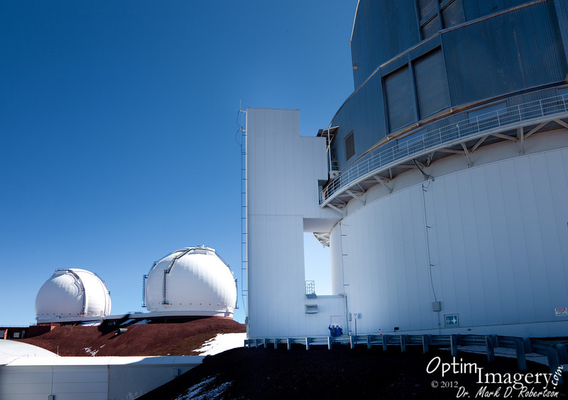 You can see Marsha and Steve at the door to the Subaru Telescope facility.  The twin Keck telescopes are in the white domes to your left.