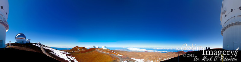 "Near 360-degree panorama from Mauna Kea.  The observatory which, in this photo, is split in 2 (at both the right and left ends of the panorama) is the Canada-France-Hawaii Telescope, with a primary mirror diameter of 3.58 meters.  The silver one to your left is the Gemini, an 8.1 m telescope with a twin in Chile (thus the name Gemini).  The one with the ""visor"" sticking out from the top is the UH88, an 88-inch telescope owned by the University of Hawaii.  Next (the small-appearing one just to your left from the furthest-left road) is the United Kingdom Infrared Telescope, with a 3.8 meter mirror.  On top of the far hill is the Subaru Telescope (the national telescope of Japan).  Then comes the twin Keck Observatories which, at 10 meters made each of them tied for the largest optical telescope in the world when they were built (now, I believe, they are tied for number 2).  You can see Steve and Marsha then at the base of the Canada-France-Hawaii Telescope to your right.<br /> <br /> This is a 19-photo panorama.  You can get some pretty amazing detail if you bring it up to full size.  To do this, hover your cursor over the photo and click on ""Original"" in the resulting pop-up menu.  You can navigate using the scroll bars to the right and bottom of your screen.  Clicking on the enlarged photo will return you to the SmugMug format album."